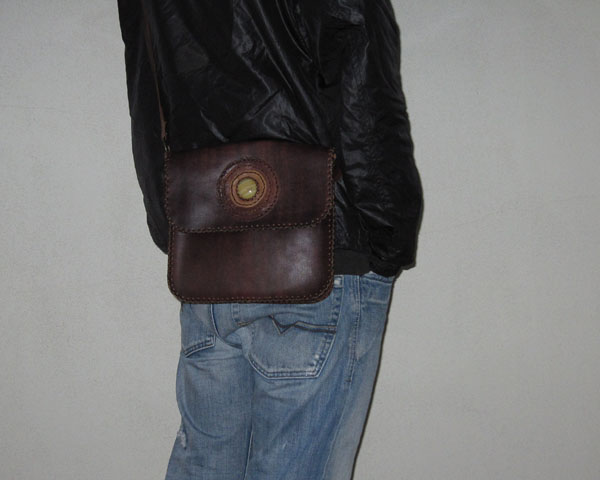 fbc551ccad Diversity- Man purses come in many different shapes and sizes, styles and  options. From leather messenger bags to knit handbags, there are many  different ...