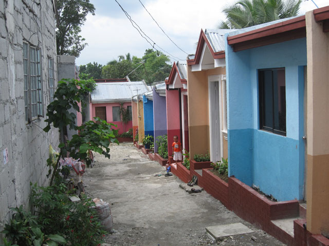Building Houses with Gawad Kalinga in Manila Philippines on evergreen homes, habitat for humanity homes, mother teresa homes, cebu homes, philippines homes, manila homes,