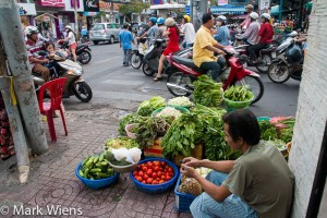 Fresh vegetables, sold on the sidewalk in Saigon