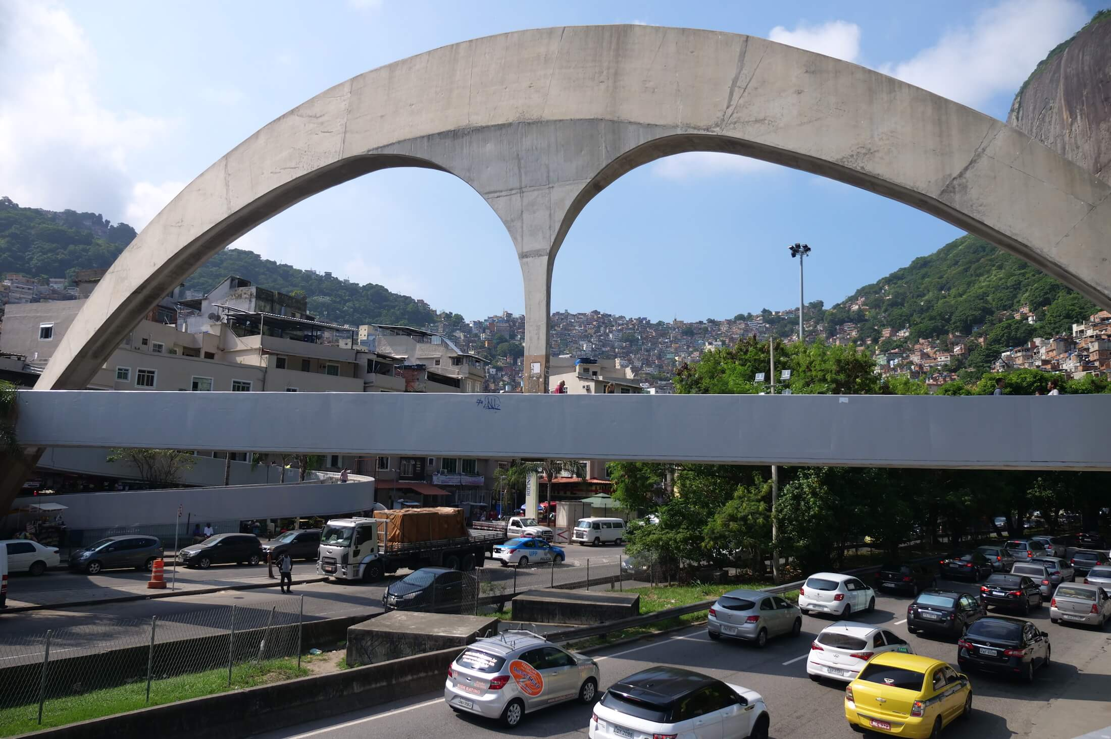Take a bus, or taxi, and get off when you see this huge arch over the entrance to Rocinha favela