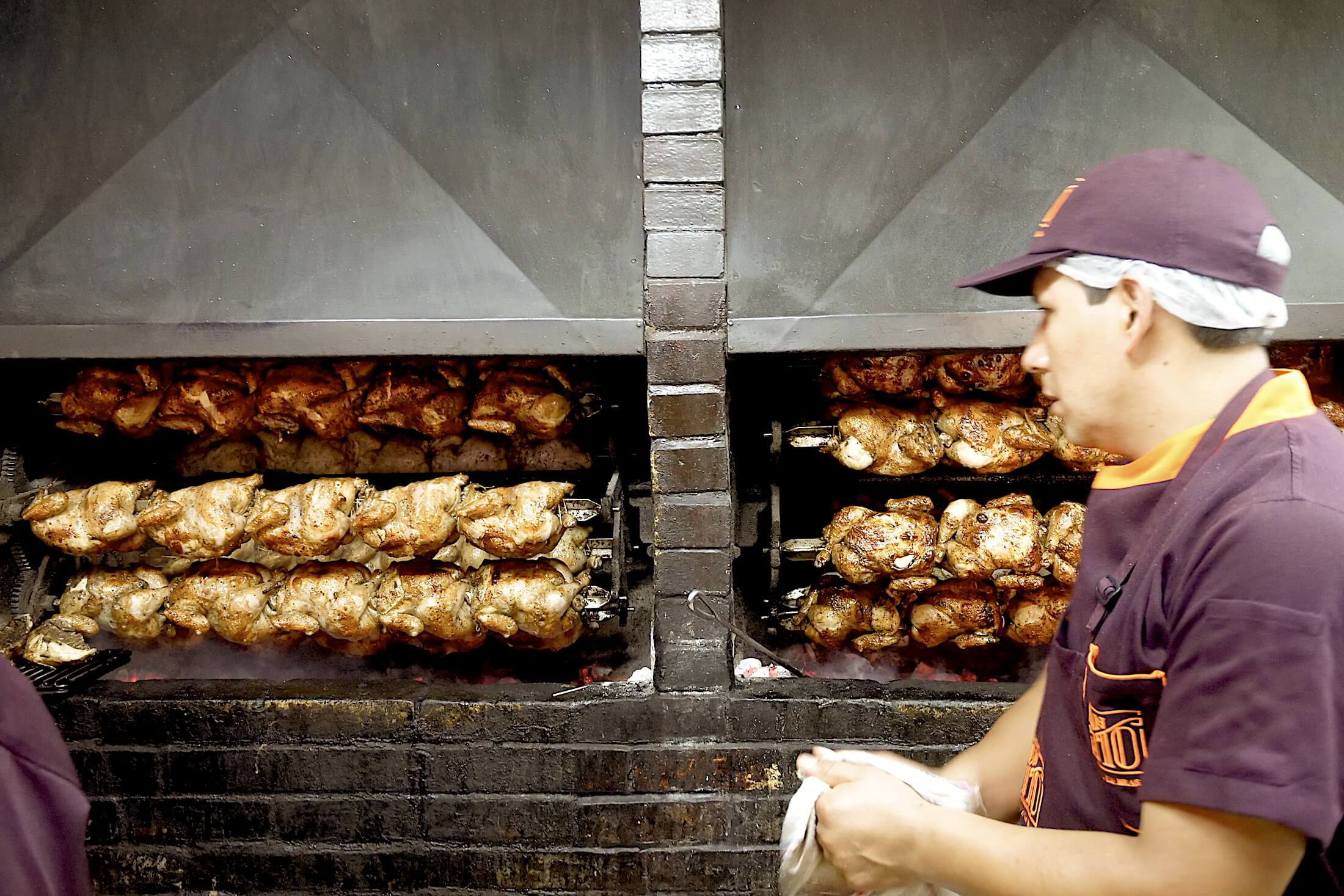 Pollo a la Brasa grilling chickens at Don Tito's