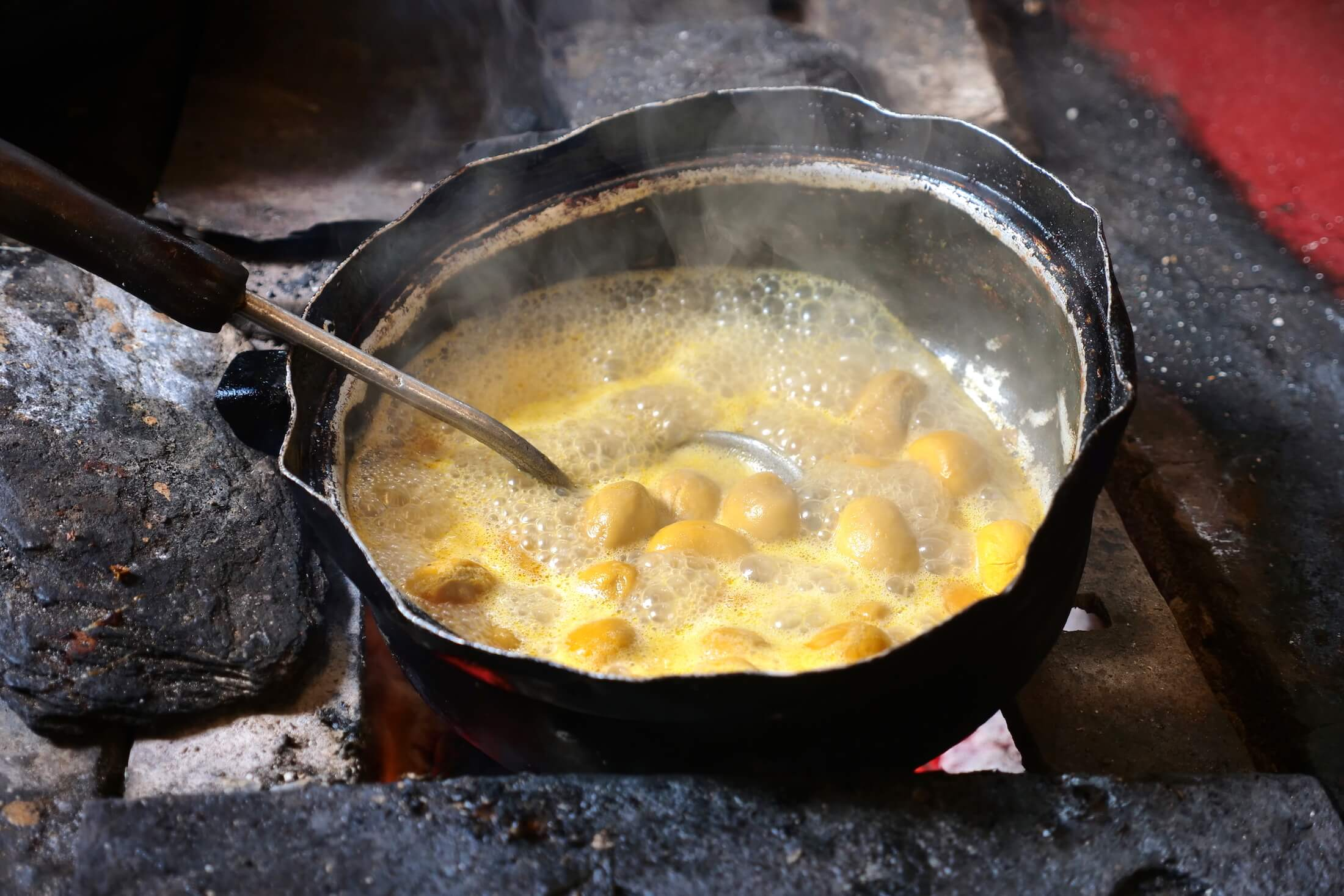 pequi fruit frying in just oil and its own moisture