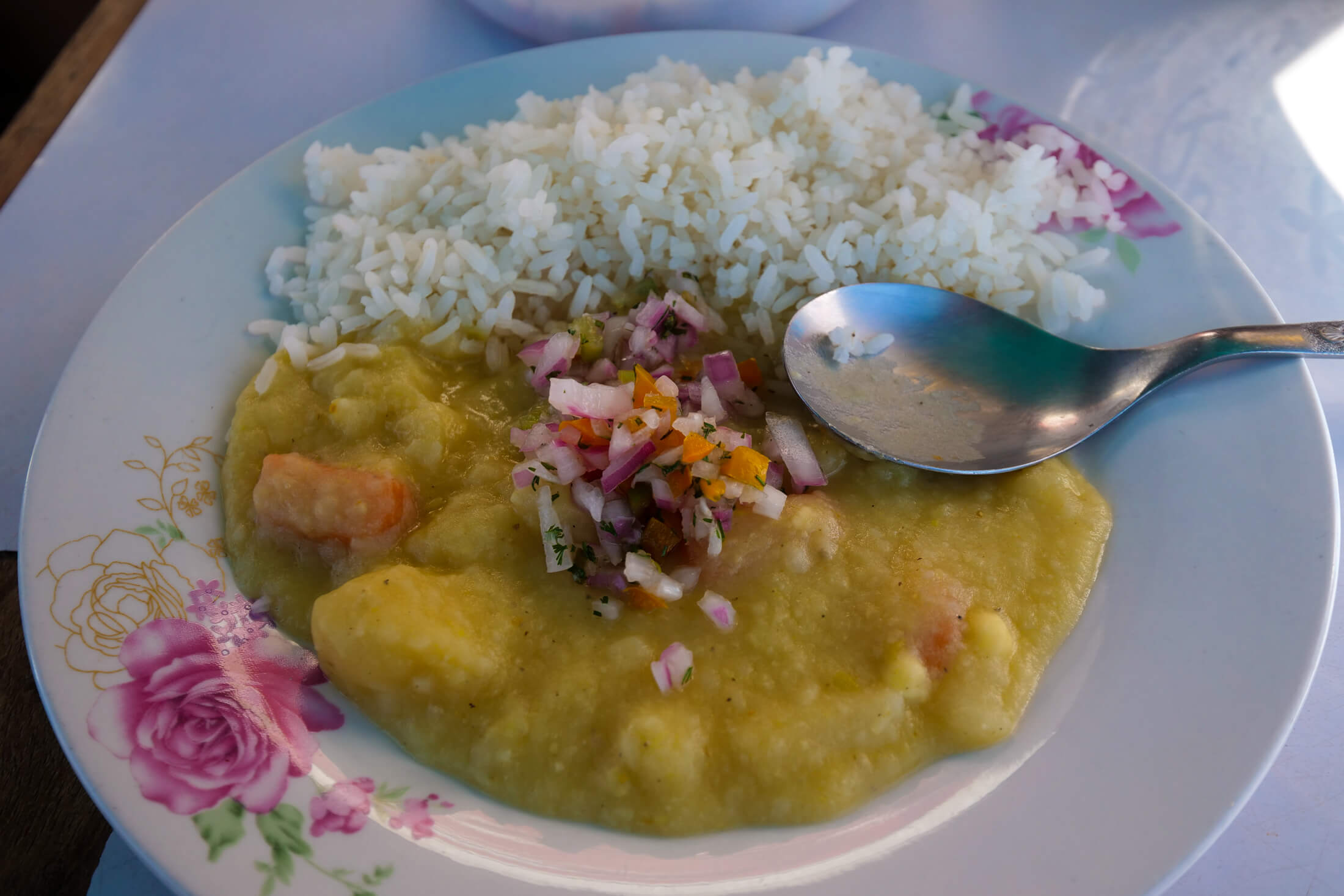 Kapchi de Habas is A hearty plate of cauliflower, carrots, and potatoes to go with white rice