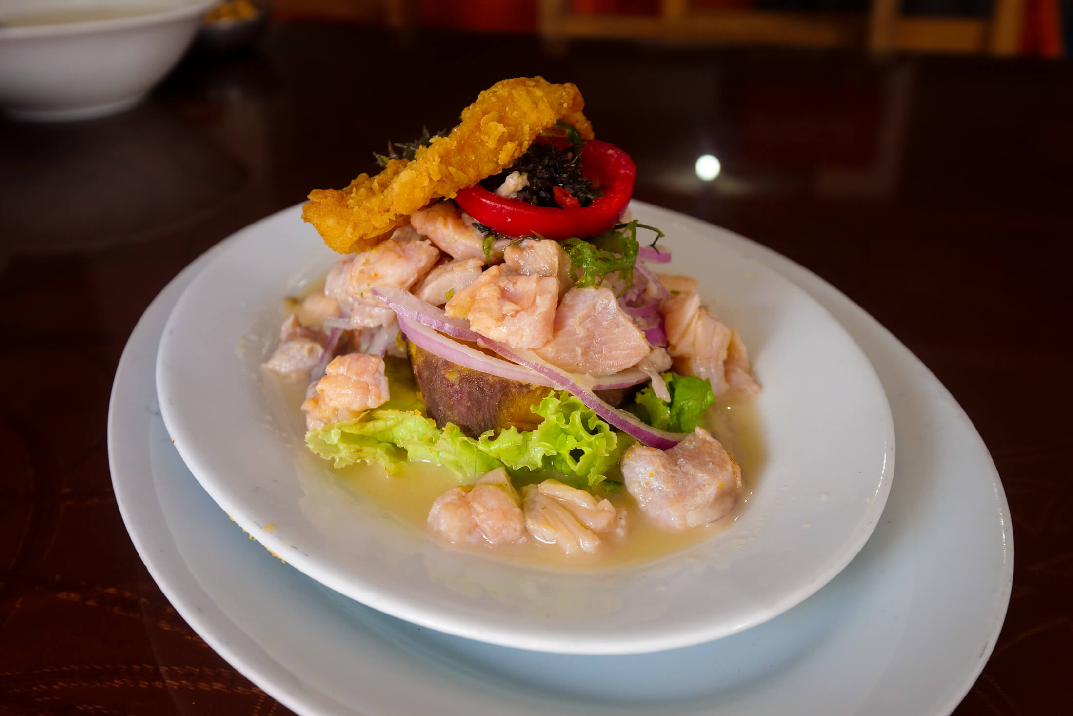 Raw ceviche made with trucha, which is trout, from Cusco's lakes or rivers