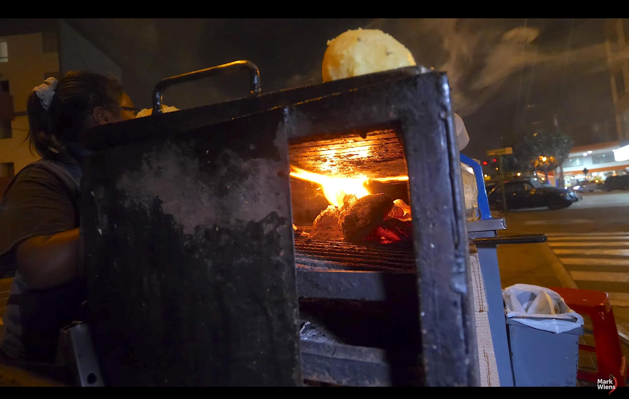 A workman's toolbox grill device, with the inside trays full of fire instead