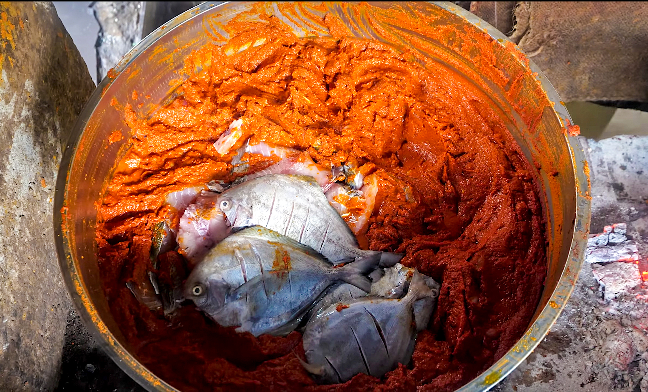 Each fish enters this massive mother pot full of Kerala-style curry paste
